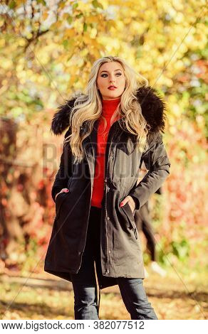 Modern Outfit For Youth. Girl In Warm Coat Stand In Park Nature Background Defocused. Create Fall Ou