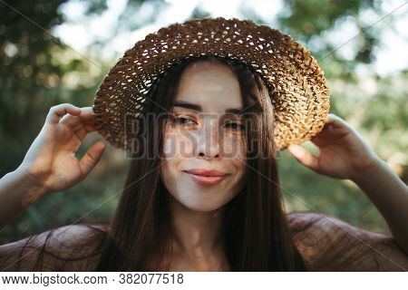 Summer Portrait Of Attractive Young Freckled Woman With Healthy Skin And Dark Hair. Youth, Health, A