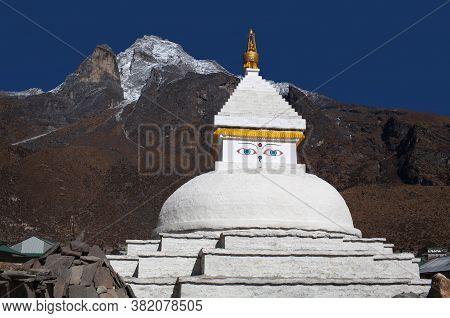 Mount Khumbila And Buddhist White Stupa Near Khumjung Village On The Way To Everest Base Camp, Khumb