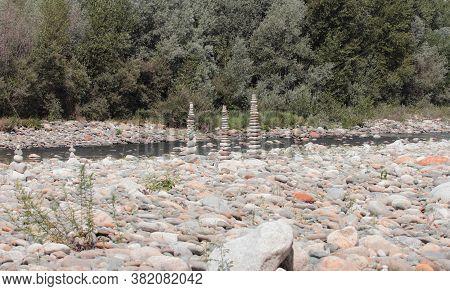 River Stones Piles Along Sesia River Piedmont, Italy