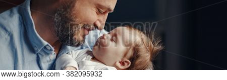 Closeup Of Middle Age Bearded Caucasian Father With Newborn Baby. Smiling Proud Man Parent Holding C
