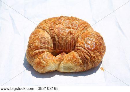 Croissant. Butter Croissant. Fresh Baked Croissant on white paper.