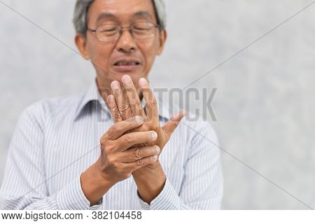 Elder Hand Pain With Trigger Finger Or Rheumatoid Arthritis.