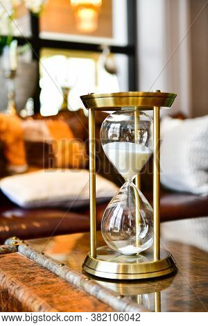 Sand Running Through The Bulbs Of An Hourglass Measuring The Passing Time In Living Room.home Decora