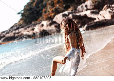 Beautiful Young Woman Having Fun On The Beach