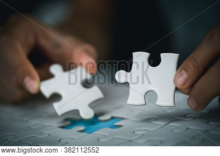 Hand Of Woman Connecting Jigsaw Puzzle, Business Solutions, Success And Strategy, Business Partnersh