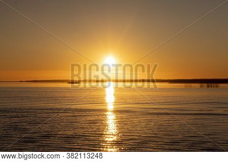 Sunset Sky Background. Gold Sunset Sky With Evening Sky Clouds Over The Lake With Fog.crystal Clear