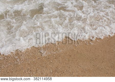 Sea Waves On A Sandy Shore In Afternoon