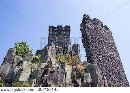 Ruines Of Hazmburk Castle Of Ceske Stredohori Range. View On The White Tower, Rocks And Walls.