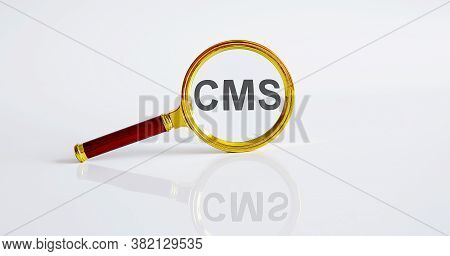 Magnifier With Text Cms On White Background