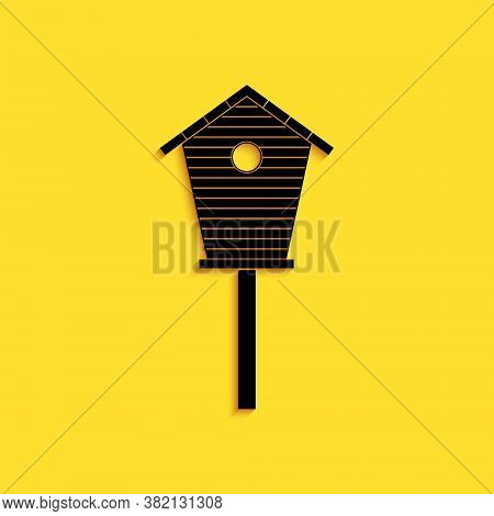 Black Bird House Icon Isolated On Yellow Background. Nesting Box Birdhouse, Homemade Building For Bi