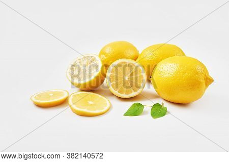 Lemons Background. Group Of Lemons With Leaves On White Background. Citruses And Vitamins. Creative