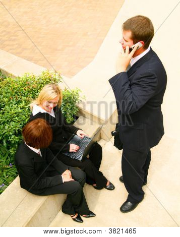 Three Business Poeple Working Outdoor