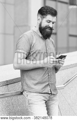 Sms Chat Online. Happy Hipster Text Sms Via Smartphone Urban Outdoor. Sms Messaging. Short Message S