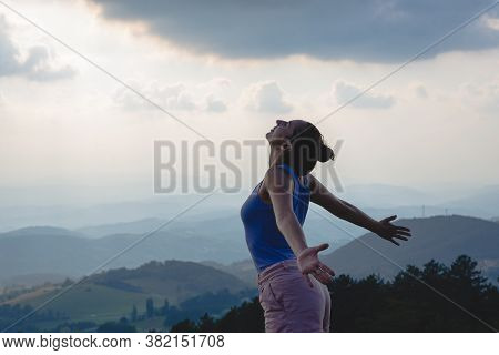 Beautiful Woman Smiling In Nature. Happy People Lifestyle. Woman Smiling In Sunset With Arms Outstre