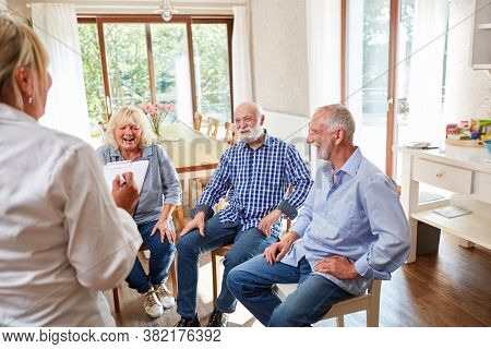 Group of seniors in a talk therapy in a nursing home with a therapist