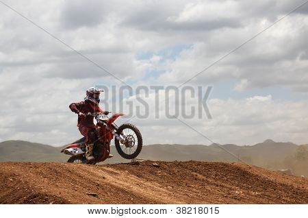 Motocross Rider Preparing To Jump