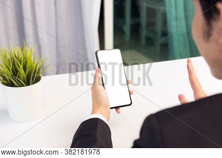 Work From Home, Back View Of Asian Young Businessman Smile Wearing Suit Video Conference Call Or Fac