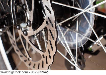 The Brake System In A Modern Sports Bike, Brake Disc And Brake Caliper With Brake Pads, Background,
