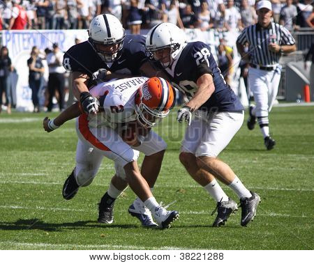Illinois quarterback No. 2, Nathan Scheelhaase #2 is tackled