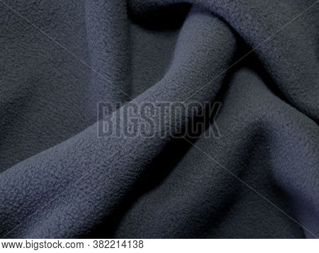 Blanket Made Of Fluffy Fleece Fabric. The Background Is Made Of Soft Plush Fleece Material With A Lo