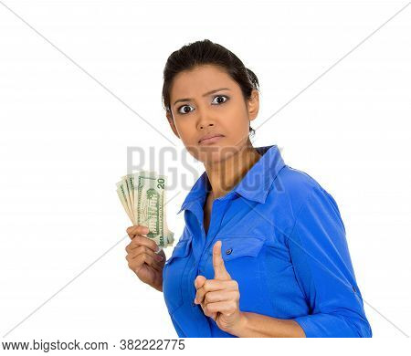 Closeup Portrait Of A Greedy Young Woman Holding Dollar Banknotes Tightly, Isolated On White Backgro