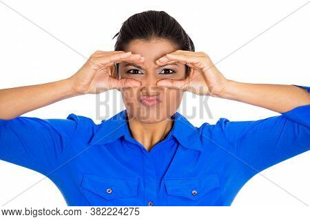 Closeup Portrait Of Young Pretty Woman, Peeking Through Her Fingers Like Binoculars, Looking Angry A