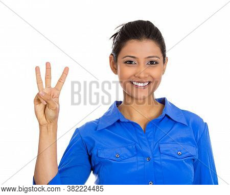 Closeup Portrait Of A Young Woman Giving A Three Fingers Gesture With Hand Isolated On White Backgro