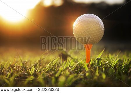 Golf Balls On Tee In Beautiful Golf Courses With Sun Rise Background.important Equipment To Play Gol