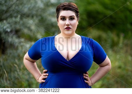 Sexy Plus Size Fashion Model In Blue Dress With A Deep Neckline Outdoors, Beautiful Fat Woman With B