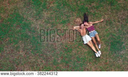 couple of amcihe lying on a green lawn