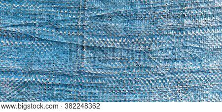 Blue Synthetic Burlap, Close-up. Polyethylene Material. Interlacing Of Polyethylene Fibers And Threa