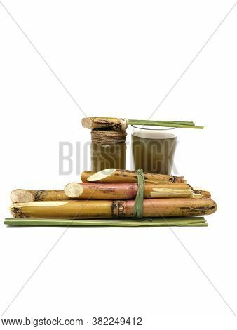 Sugarcane Juice In Glass Jar With Sugarcane Pieces Isolated On White Background In Vertical Orientat