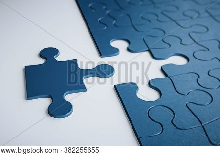 Incomplete Puzzles On White Table. Business And Teamwork Concept. 3d Rendering
