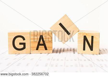 Word Gain. Wooden Small Cubes With Letters Isolated On White Background With Copy Space Available.bu