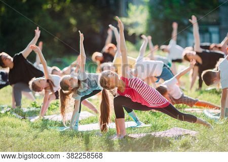 Yoga Classes Outside On The Open Air. Kids Yoga,