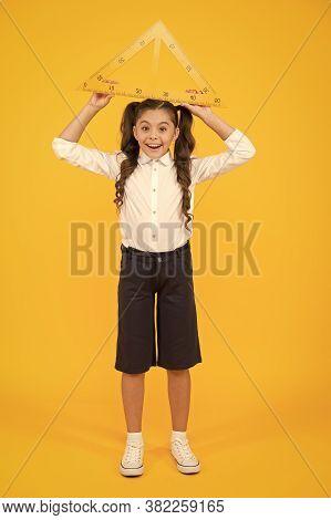 Schoolgirl School Uniform Hold Big Ruler Geometry School Lesson. Kid Cute School Student Study Mathe