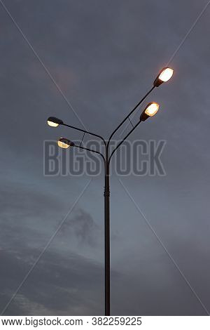 A Pole With Electric Lights Against The Twilight Sky