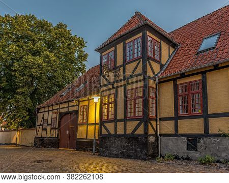 Half-timbered House In The Breaking Morning Light On A Cobblestone-street In The Small Town Faaborg,