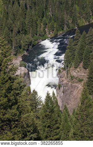 Lower Mesa Falls In Idaho Along The Mesa Falls Scenic Byway On A Bright Sunny Day With Wild And Fast
