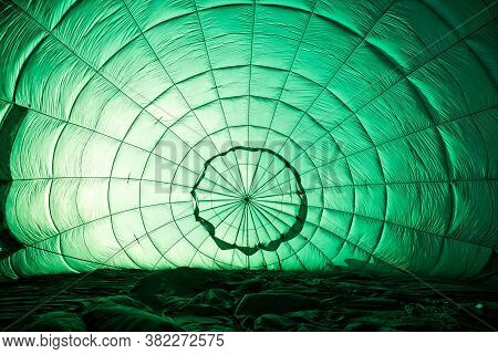 The Inner Surface Of The Green Balloon. The Process Of Filling The Ball With Gas. Preparation For Th