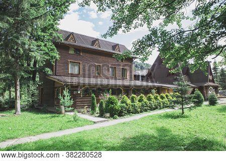 Carpathians, Ukraine, June 2018: Beautiful Wooden Houses In The Carpathians In The Forest