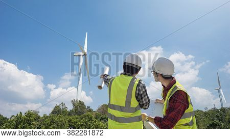 Two Engineer Discussion With Plan To Maintenance Wind Turbine Generator. Renewable Energy With Wind