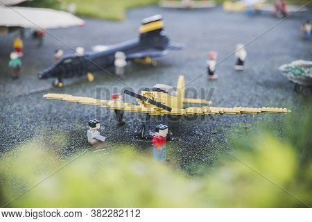 Billund, Denmark, July 2018: Toy Airplane And Little Men At The Miniature Airfield In Legoland