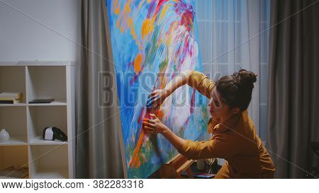 Painter Making A Masterpiece With Her Fingers In Art Studio For Art Gallery.