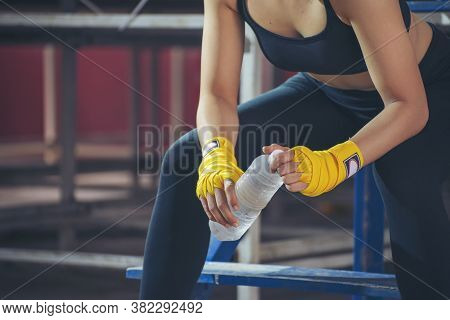 Muay Thai Woman And Healthy Concept. Boxer Drink Water During Exercise Break. Boxing Women Prepare T