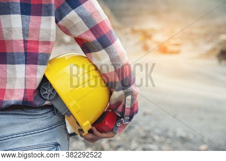 Woman Engineer And Safety Officer Concept.young Woman Engineer Holding Safety Hat (helmet) And Safet