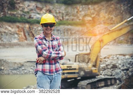 Woman Engineer And Safety Officer Concept.young Woman Engineer Wear Safety Hat (helmet), Safety Glas