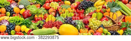 Large fruit colorful wide background of fresh and healthy vegetables and fruits.