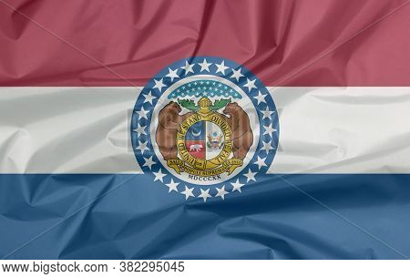 Fabric Flag Of Missouri. Crease Of Missouri Flag Background, The States Of America, Red White And Bl